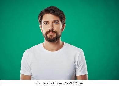 bearded man t-shirt lifestyle green background emotions