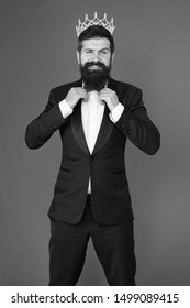 Bearded man in tuxedo and bow tie. Big boss. Formal event. King crown. Man groom in wedding suit. Egoist. Businessman in tailored tuxedo and crown. Formal tuxedo wear male fashion. Happy tuxedo man.