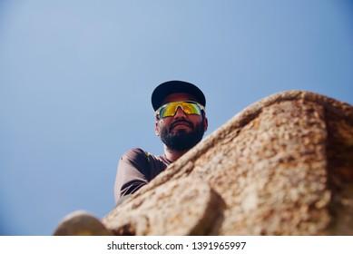 Bearded man wearing sunglass unique closeup portraits photo