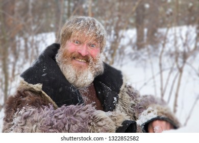 Bearded man in the winter woods. Close up portrait of a bearded man in the winter.