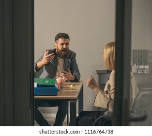 Bearded man and woman discuss company budget. Angry boss shout at accountant in office. Businessman blame financier in money crisis. Business conflict and confrontation. Savings and handout concept.