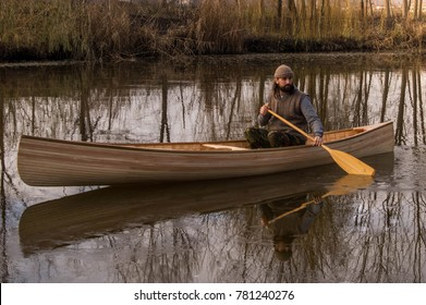 Bearded Man In Wooden Canoe Picture Taken From The Front Side