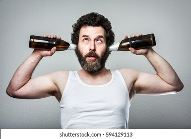 Bearded Manly Man with Beer Bottles in his Ears. Funny guy!