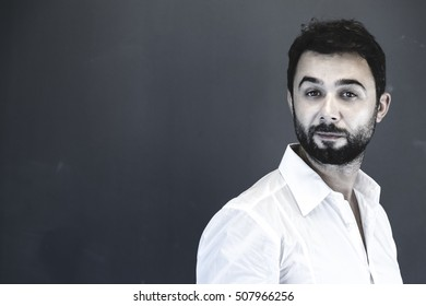 Bearded masculine young man studio portrait