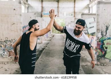 Bearded men make handshake for friendship and respect .