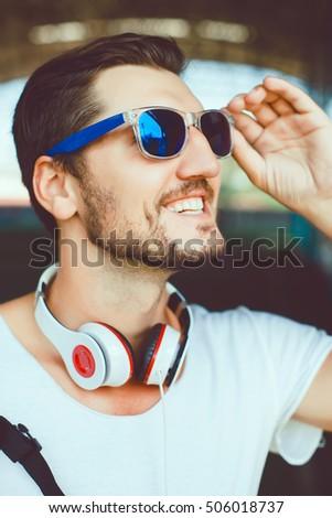 82e1db0decc Bearded Muscular Man Wearing Black Tshirt Blank Snapback Cap Summer Time.Young  Men Using Smartphone Headphones Looking Screen Smiling.Horizontal.