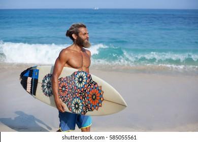 https://image.shutterstock.com/image-photo/bearded-surfer-surfboard-walking-on-260nw-585055561.jpg