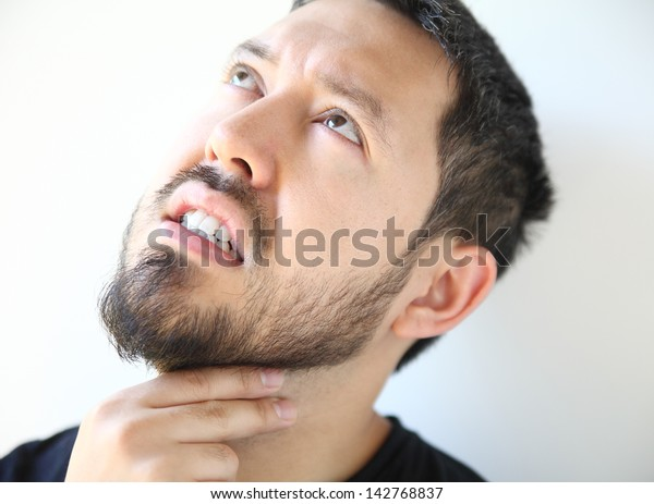 bearded thirty-year old man has pain in his throat