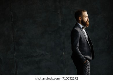 Bearded young businessman standing on modern loft office