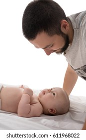 Bearded young dad with newborn in studio