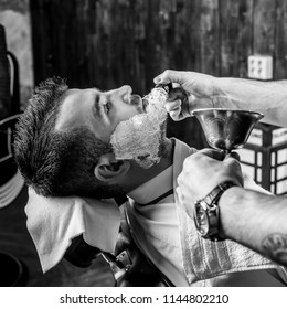 Beards correction in barbershop salon. Black-white photo.