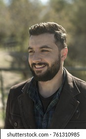Beared 35 years old man portrait in outdoors image with full beard and modern hairstyle
