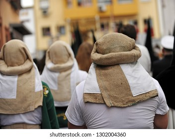 Bearers (costaleros) of the brotherhood of the Our Lady of Hope (Esperanza) of Triana. Procession of Holy Week (Semana Santa) in Seville. Spain