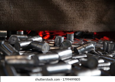 Bearing production plant. Metal  rolls annealing or heat treatment in special furnace. Low depth-of-field. Abstract industrial background. Kazakhstan.