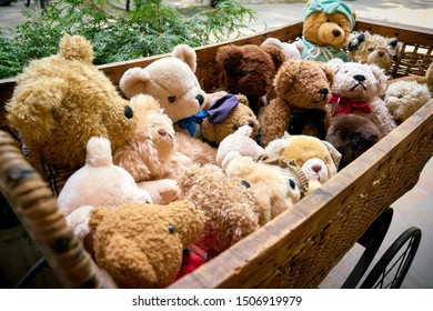 Bears as a souvenir in a doll carriage in front of a souvenir shop in Berlin