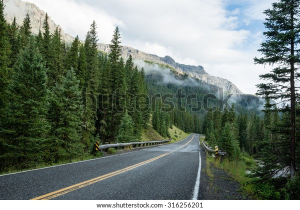 Beartooth highway through Wyoming, Montana. The most scenic drive in the US on the way to Yellowstone National Park surrounded by lush greenery and mountain peaks