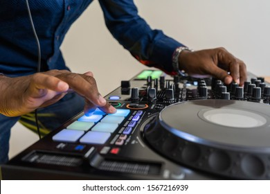 Beat machine device for electronic music composer.Techno dj play and remix musical tracks with modern drum machine.Professional sound recording studio equipment for disc jockey and producer