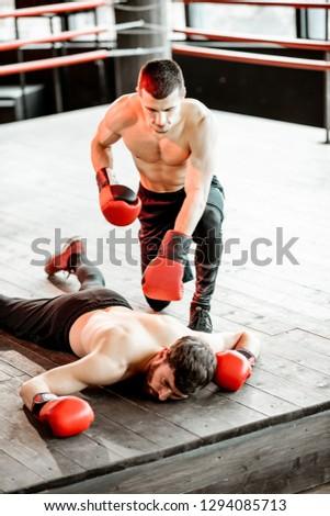 Beaten boxer lying knocked