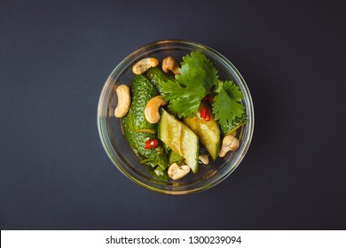 Beaten Chinese cucumbers with cashews isolated