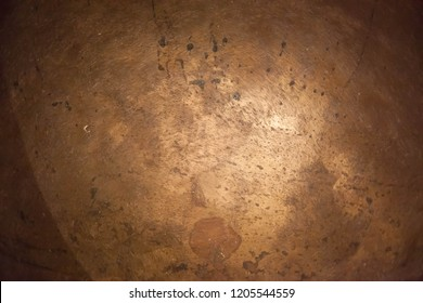 Beaten copper kettle in Abstract