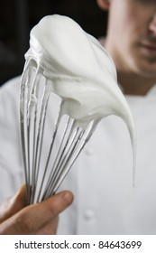 Beaten egg whites on a whisk