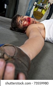 Beaten man laying on the floor after fight. Knockout concept. Hand in focus, face unfocused