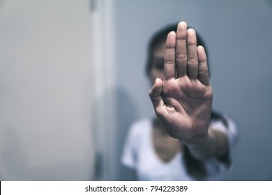 Beaten women holding her hand up