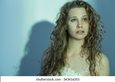 Beaten up young woman with messy hair and a black eye