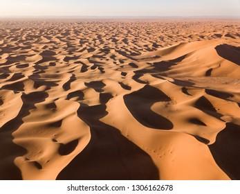 Beatiful aerial landscape with big sand dunes in Sahara desert at sunrise
