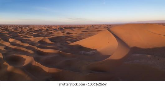 Beatiful aerial panorama landscape with big sand dunes in Sahara desert at sunrise