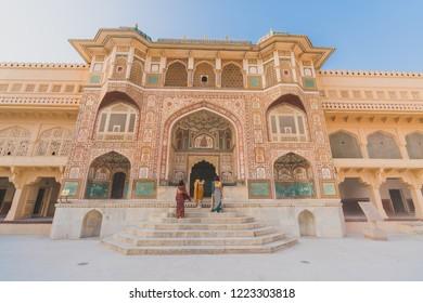 Beatiful Asia girl waering Traditional India Dress ( Sali ) in front of Main Entrance Amber Palace, Jaipur, Rajasthan - India