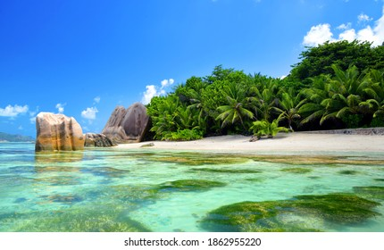 Beatiful beach Anse Source d'Argent with big granite rocks in sunny day. La Digue Island, Seychelles. Tropical destination.