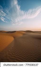 a beatiful Desert landscape with sky. Sand dunes at sunset