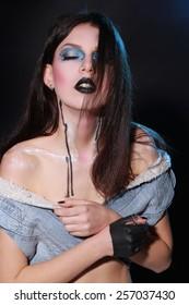 Beatiful girl with creative black make-up