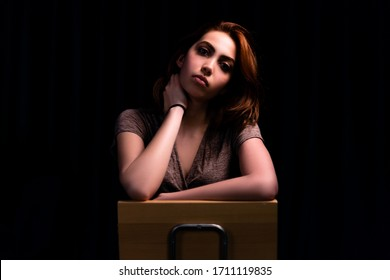beatiful girl in dramatic rembrandt lighting white fashionable