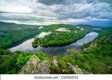 "Beatiful lookout on the Moldau river (""Vltava"") with dramatic clouds. Place called ,,Smetanova vyhlidka,,. before closing for tourists.  Trebsin, Krnany, the Czech Republic."
