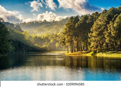 Beatiful nature lake and forest , Pang oung lake and pine forest in Mae Hong Son , Thailand , nature landscape of Thailand . Pang oung is popular travel destination in Thailand