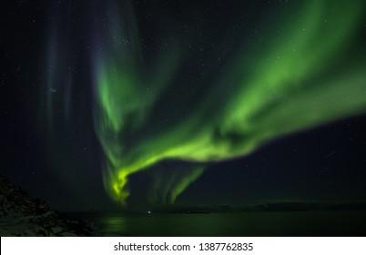 Beatiful nothern lights over Lofoten islands. Norway.