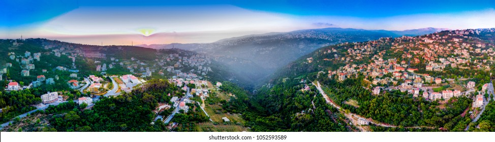 Beatiful panoramic landscape view of a Lebanese village on a mountain side at sunset with a sea view