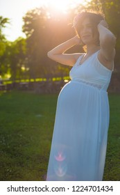 Beatiful Pregnant women smiling during the sunset