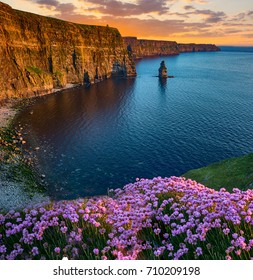 beatiful sunset from the cliffs of moher in county clare, ireland. the cliffs of moher is one of irelands top tourism attractions aloing the wild atlantic way