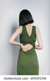 beatiful woman has back pain, isolated on background