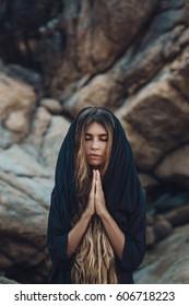 beatiful young wild woman praying