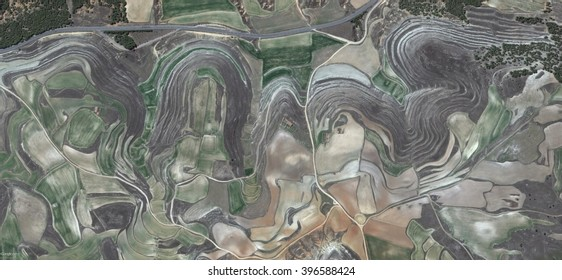 the beatles in Spain,abstract photography of the Spain fields from the air, bird's eye view, tribute to Pollock, artistic representation of human labor camps, abstract expressionism, contemporary art,