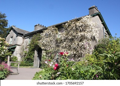 beatrix potter house hill top lake district in summer in full sun and blue sky