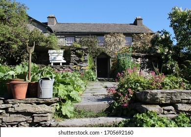 beatrix potter house hill top lake district in summer in full sun and blue sky front view