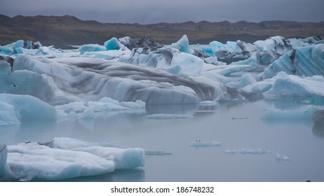 Beatufil vibrant picture of icelandic glacier and glacier lagoon with water and ice in cold blue tones