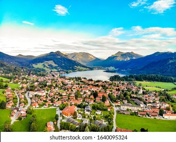 Beatuful aerial panorama view on Schliersee lake, town, village, alps mountains, blue sky, clouds. Bavaria, Bayern, nearby Munich, Rosenheim. Germany