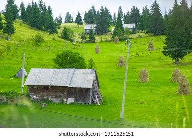 Beatuiful green landscape in Transylvania and hay bales