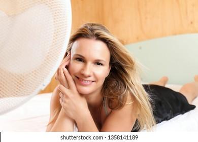 A Beatyful woman in front of a Fan